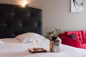 Een bed of bedden in een kamer bij Résidence Hôtelière Natureva & Spa