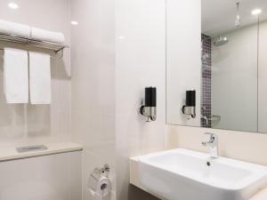 Ein Badezimmer in der Unterkunft Hotel Traveltine