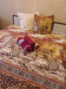 Кровать или кровати в номере Apartment Happiness