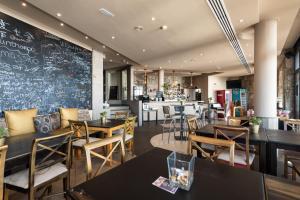 Restaurant ou autre lieu de restauration dans l'établissement Holiday Club Jardin Amadores