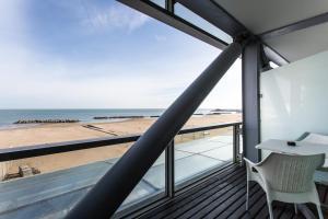 A balcony or terrace at Kursaal Hotel