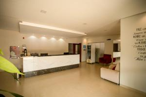The lobby or reception area at Pianna Hotel