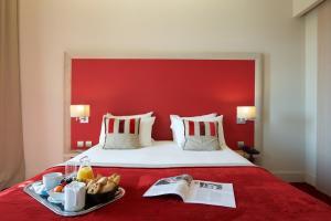 Un ou plusieurs lits dans un hébergement de l'établissement Hôtel du Parc