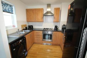 A kitchen or kitchenette at Maritime Guest House
