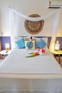Cama ou camas em um quarto em Pousada e Chalés Aquarius