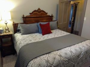 A bed or beds in a room at Stone Gables Inn