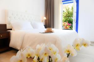 Ένα ή περισσότερα κρεβάτια σε δωμάτιο στο Armata Boutique Hotel