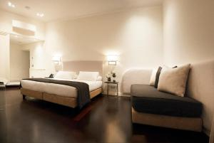 A bed or beds in a room at Hotel Scalinata Di Spagna