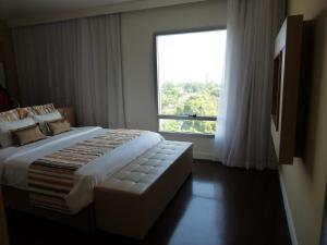 Cama o camas de una habitación en Mercure Manaus