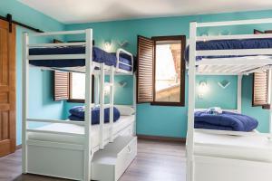 A bunk bed or bunk beds in a room at Villa Palatina