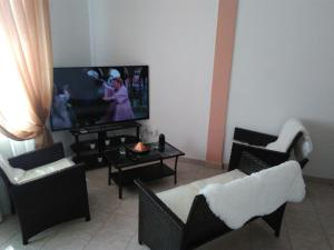 A seating area at H&C Luxury Apartment