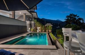 The swimming pool at or near Bayu Cottages