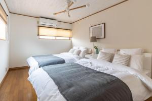 Bijou Suites Momoにあるベッド