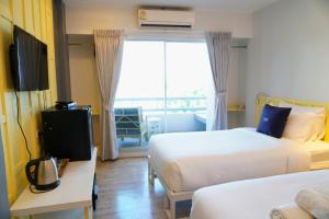A bed or beds in a room at Riverview Residence