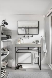 Een badkamer bij Ajuma Strandkamers