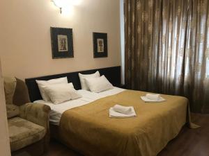 Кровать или кровати в номере Guest House Piramida