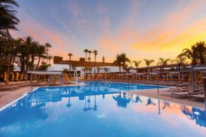The swimming pool at or near Hotel Riu Palace Oasis
