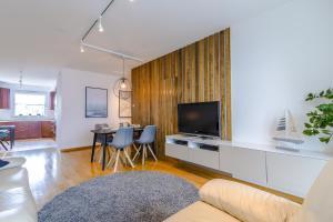Telewizja i/lub zestaw kina domowego w obiekcie Rent a Flat apartments - Obrońców Wybrzeża St.