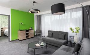 A seating area at ibis Styles Halle