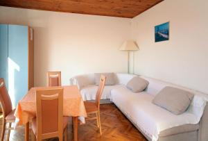 A seating area at Apartments with a swimming pool Soline, Dubrovnik - 4762