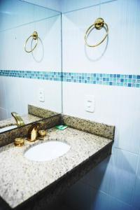 A bathroom at Candango Aero Hotel