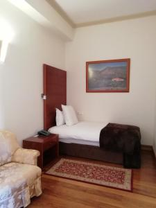 A bed or beds in a room at Hotel Rural Quinta Do Pego