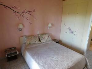 Кровать или кровати в номере Georgia Apartments & Studios Corfu