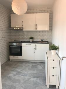 A kitchen or kitchenette at Luxury Loft Malaga Torremolinos Sol