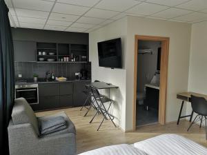 A kitchen or kitchenette at Centrum Hotel