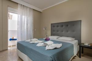 Un ou plusieurs lits dans un hébergement de l'établissement Lefka Hotel & Apartments