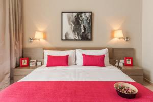 Ein Bett oder Betten in einem Zimmer der Unterkunft Ascott Aden Shenzhen