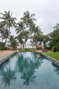 The swimming pool at or near Villa Saffron Hikkaduwa
