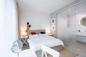 Łóżko lub łóżka w pokoju w obiekcie Taras Na Fali Apartments