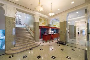 The lobby or reception area at Grand Hotel Union