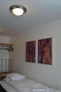 A bed or beds in a room at BB-Hotel Aarhus Havnehotellet