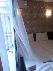 Кровать или кровати в номере Guest House Oleandr