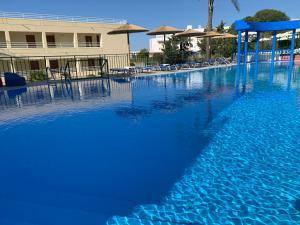The swimming pool at or near Romantza Mare