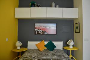A bed or beds in a room at Estudio do OC