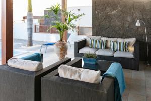 Coin salon dans l'établissement Luxury Villa Private Pool Lanzarote