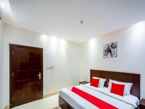 Cama ou camas em um quarto em Juina Castle alriyad