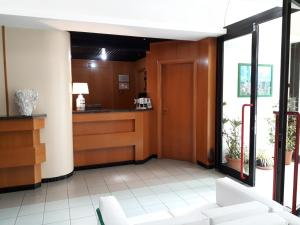 The lobby or reception area at Hotel Neptunus