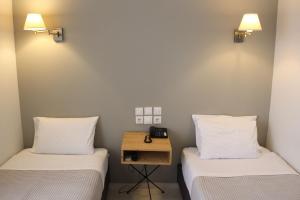 Letto o letti in una camera di Messini Hotel