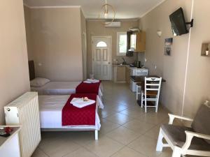Area soggiorno di Petros Rooms & Apartments