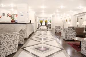 The lobby or reception area at CHA Prime Curitiba