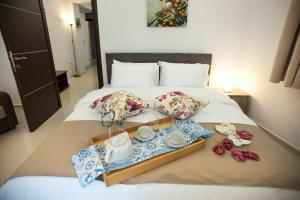 A bed or beds in a room at DREAM APPARTMENT 1 PEREA