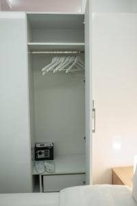 A bed or beds in a room at DREAM APPARTMENT 2 PEREA