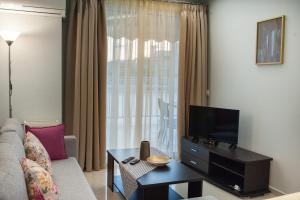 A television and/or entertainment center at DREAM APPARTMENT 2 PEREA
