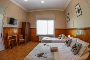 Cama o camas de una habitación en Hotel Albatros