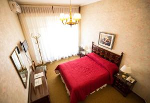 A bed or beds in a room at Grand Hotel Rio Cuarto