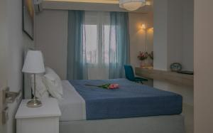 A bed or beds in a room at Evgenia Apartment